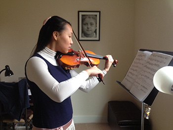 Eva Lu performs her piece at her lesson.